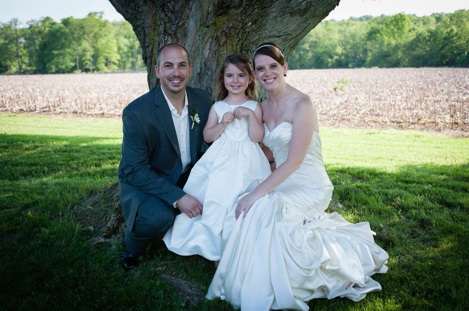 Jocelyn Mader with her husband and daughter on her wedding day, before she was diagnosed with breast cancer